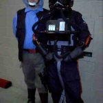 Tony dressed as a Rebel Fleet Trooper, standing with a TIE Pilot.